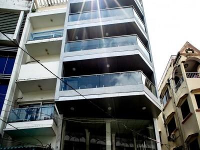 Tòa nhà mặt tiền Đường Đặng Dung, P.Tân Định, Q1. Giá thuê : 4,100 USD / tháng.